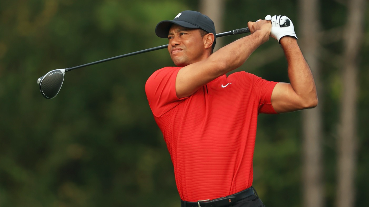 Tiger Woods shares first photo since car accident, seen smiling on crutches and in walking boot on golf course